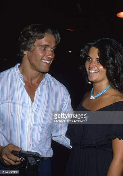 Arnold Schwarzenegger and future wife Maria Shriver collect donations for Senator Ted Kennedy's 1980 Presidential bid in June 1980 at Flippers Roller...