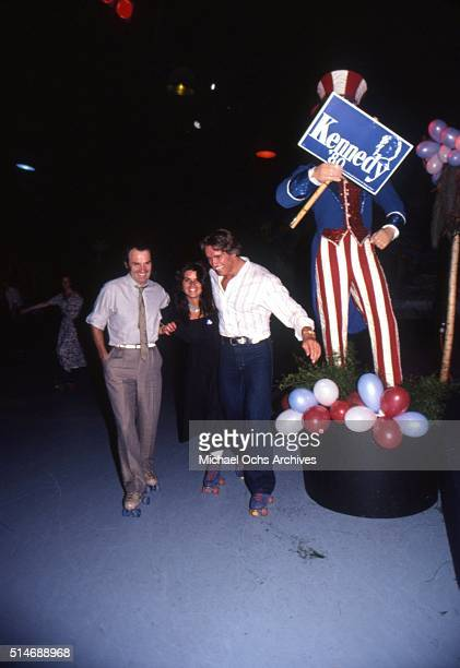 Arnold Schwarzenegger and future wife Maria Shriver with Giorgio Moroder and friends collect donations for Senator Ted Kennedy's 1980 Presidential...