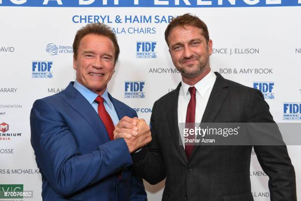 Arnold Schwarzenegger and Gerard Butler at the FIDF Western Region Gala at The Beverly Hilton Hotel on November 2 2017 in Beverly Hills California