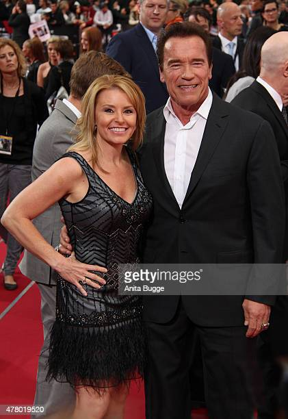 Arnold Schwarzenegger and girlfriend Heather Milligan attend the European Premiere of 'Terminator Genisys' at the CineStar Sony Center on June 21...