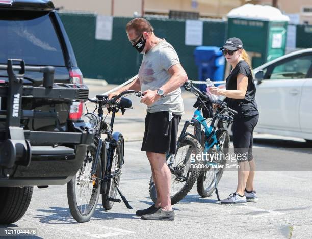 Arnold Schwarzenegger and Heather Milligan are seen on April 26 2020 in Los Angeles California