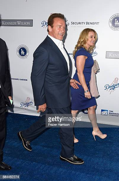Arnold Schwarzenegger and Heather Milligan arrive at the Los Angeles Dodgers Foundation Blue Diamond Gala at Dodger Stadium on July 28 2016 in Los...