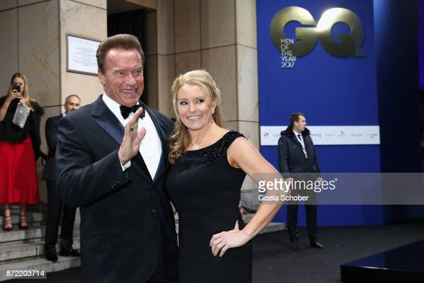 Arnold Schwarzenegger and Heather Milligan arrive for the GQ Men of the year Award 2017 at Komische Oper on November 9 2017 in Berlin Germany