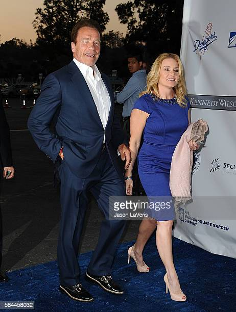 Arnold Schwarzenegger and Heather Milligan attend the Los Angeles Dodgers Foundation Blue Diamond gala at Dodger Stadium on July 28 2016 in Los...