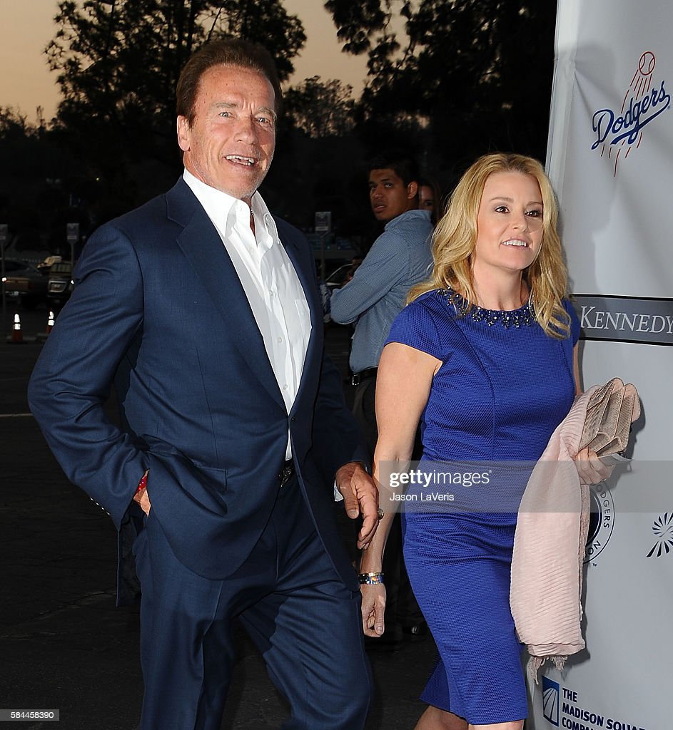 Arnold Schwarzenegger and Heather Milligan attend the Los Angeles Dodgers Foundation Blue Diamond gala at Dodger Stadium on July 28, 2016 in Los Angeles, California.