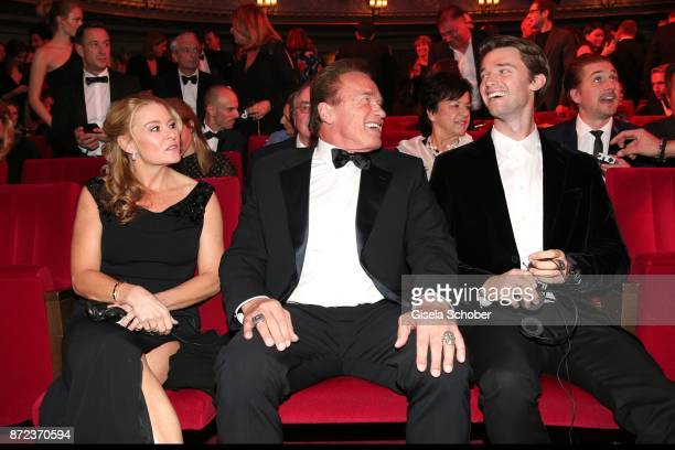 Arnold Schwarzenegger and his girlfriend Heather Milligan and his son Patrick Schwarzenegger during the GQ Men of the year Award 2017 at Komische...