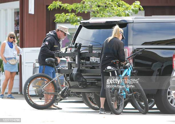 Arnold Schwarzenegger and his girlfriend Heather Milligan are seen on July 21 2020 in Los Angeles California