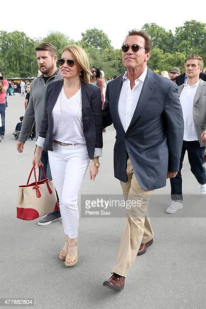 Arnold Schwarzenegger and his girlfriend Heather Milligan arrive at the Eiffel Tower for lunch at the 'Jules Vernes' restaurant on June 20 2015 in...