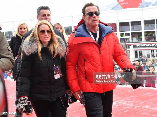 Arnold Schwarzenegger and his girlfriend Heather Milligan arrive during the Hahnenkamm race on January 20 2018 in Kitzbuehel Austria