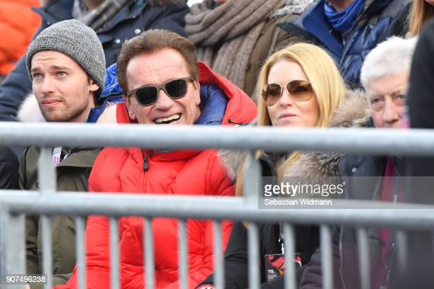 Arnold Schwarzenegger and his girlfriend Heather Milligan attend the Hahnenkamm race on January 20 2018 in Kitzbuehel Austria