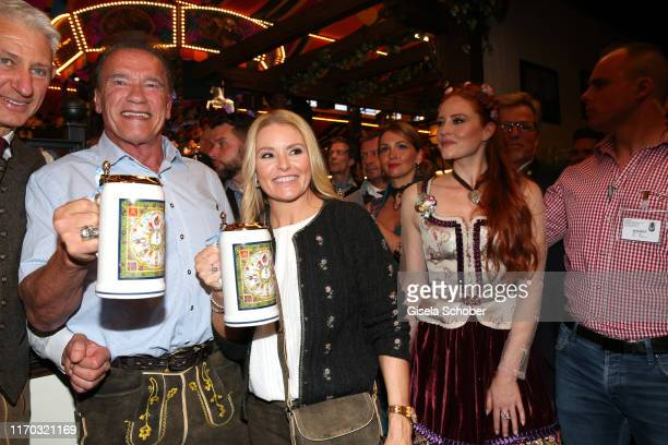 Arnold Schwarzenegger and his girlfriend Heather Milligan during the Oktoberfest 2019 at Theresienwiese on September 22 2019 in Munich Germany