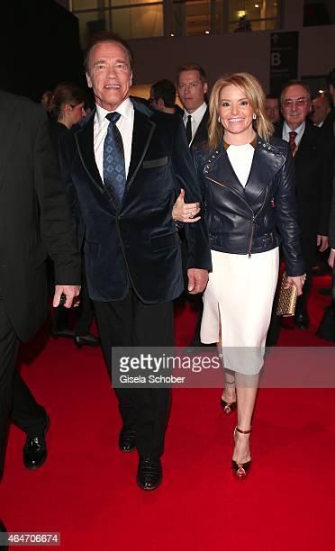 Arnold Schwarzenegger and his girlfriend Heather Milligan during the Goldene Kamera 2015 reception on February 27 2015 in Hamburg Germany