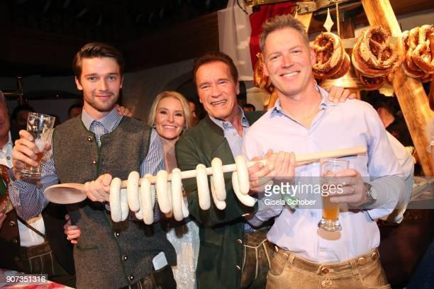 Arnold Schwarzenegger and his girlfriend Heather Milligan son Patrick Schwarzenegger and nephew Patrick KnappSchwarzenegger during the 27th...