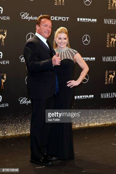 Arnold Schwarzenegger and his partner Heather Milligan arrive at the Bambi Awards 2017 at Stage Theater on November 16 2017 in Berlin Germany