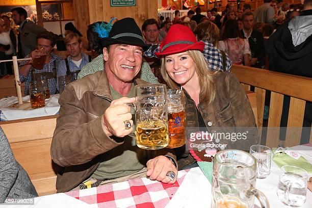 Arnold Schwarzenegger and his partner Heather Milligan visit the Schuetzenfestzelt during the Oktoberfest 2015 at Theresienwiese on September 24 2015...