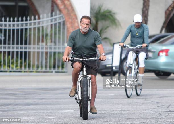 Arnold Schwarzenegger and his son Patrick Schwarzenegger are seen on July 14, 2020 in Los Angeles, California.