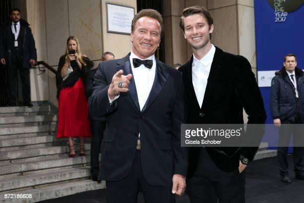 Arnold Schwarzenegger and his son Patrick Schwarzenegger arrive for the GQ Men of the year Award 2017 at Komische Oper on November 9 2017 in Berlin...