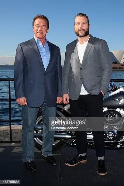 Arnold Schwarzenegger and Jai Courtney pose during a 'Terminator Genisys' photo call at the Park Hyatt Sydney on June 4 2015 in Sydney Australia