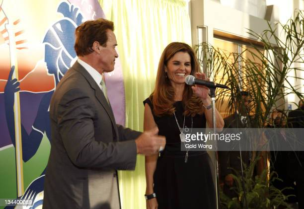 Arnold Schwarzenegger and Maria Shriver speak onstage during The 2008 Women's Conference on October 21, 2008 in Long Beach, California.