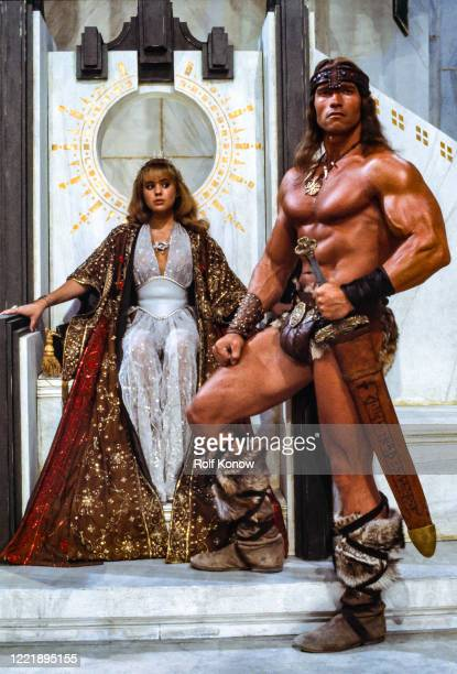 """Arnold Schwarzenegger and Olivia d'Abo on the set of """"Conan the Destroyer"""", directed by Richard Fleischer, Mexico City, Mexico, 1983"""