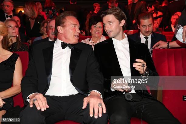 Arnold Schwarzenegger and Patrick Schwarzenegger arrive for the GQ Men of the year Award 2017 at Komische Oper on November 9, 2017 in Berlin, Germany.