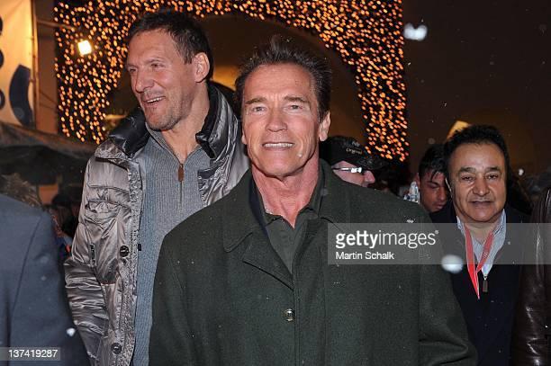 Arnold Schwarzenegger and Ralf Moeller enjoy a short city walk after shoe shopping on January 20 2012 in Kitzbuehel Austria