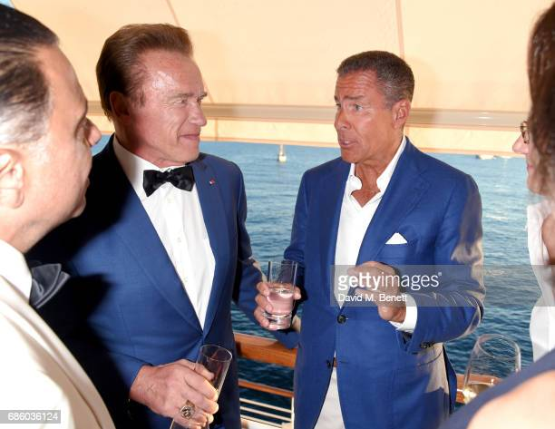 Arnold Schwarzenegger and Richard Plepler attend the Vanity Fair and HBO Dinner celebrating the Cannes Film Festival at Hotel du CapEdenRoc on May 20...