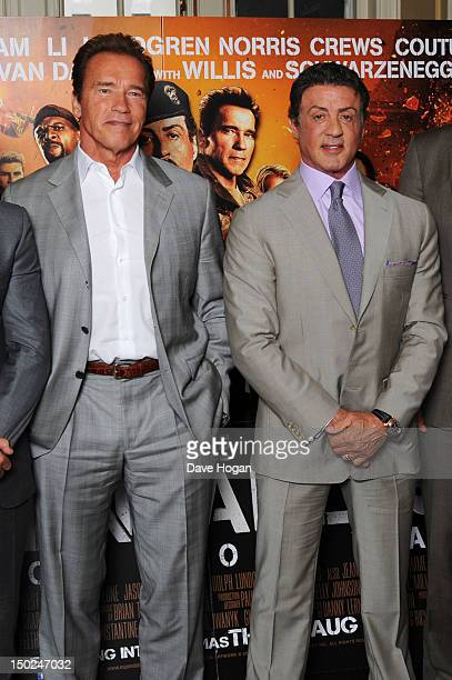 Arnold Schwarzenegger and Sylvester Stallone attend a photocall for The Expendables 2 at Simpsons On The Strand on August 13 2012 in London England