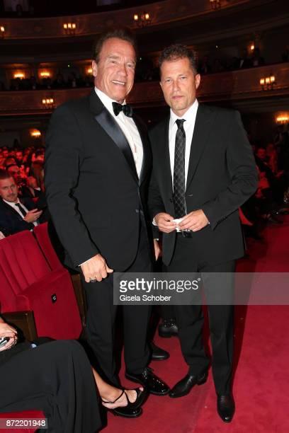 Arnold Schwarzenegger and Til Schweiger arrive for the GQ Men of the year Award 2017 at Komische Oper on November 9 2017 in Berlin Germany