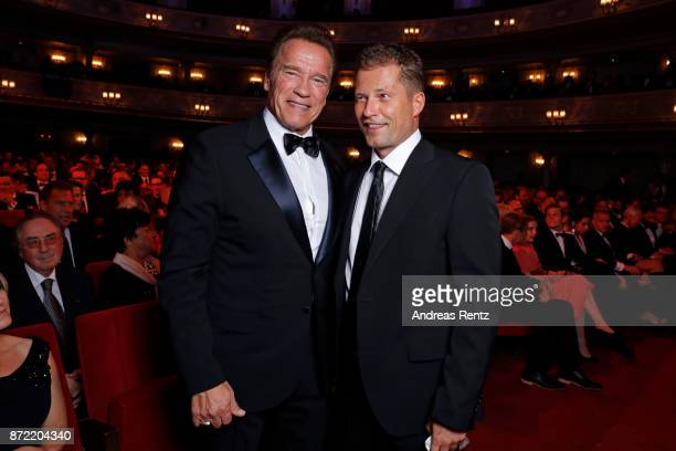 Arnold Schwarzenegger and Til Schweiger arrive for the GQ Men of the year Award 2017 at Komische Oper on November 9 2017 in Berlin Germany