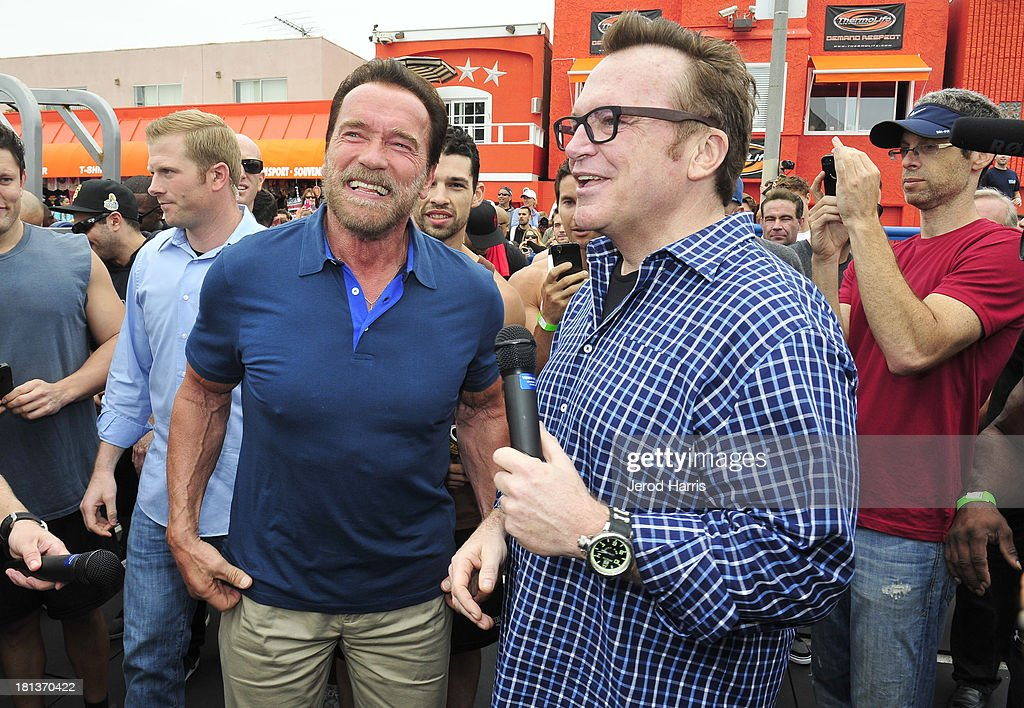 Arnold Schwarzenegger (L) and Tom Arnold attend a special body building experience hosted by Arnold Schwarzenegger at the famed Muscle Beach Venice to celebrate the launch of the Arnold Series, an exclusive line of new nutritional supplements developed by Schwarzenegger and MusclePharm on September 20, 2013 in Venice, California.