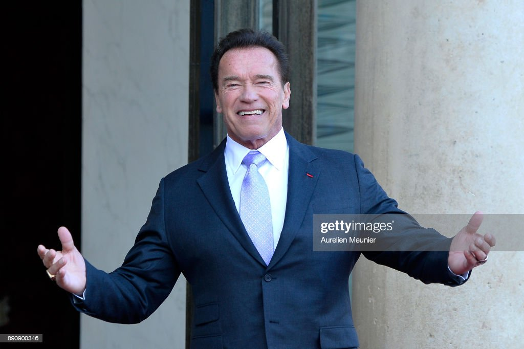 Arnold Schwarzenegger arrives for a meeting with French President Emmanuel Macron as he receives the One Planet Summit's international leaders at Elysee Palace on December 12, 2017 in Paris, France. Macron is hosting the One Planet climate summit, which gathers world leaders, philantropists and other committed private individuals to discuss climate change.