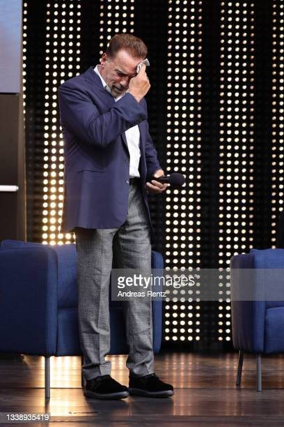 Arnold Schwarzenegger gestures during his speech in his keynote about digital sustainability during the Digital X event on September 07, 2021 in...