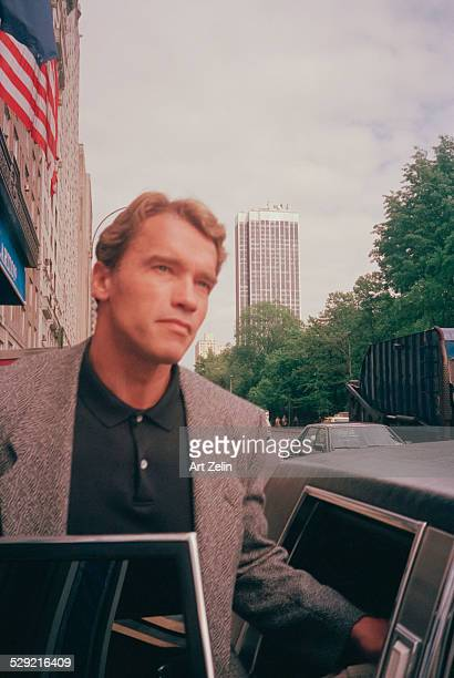 Arnold Schwarzenegger getting in to limousine on Central park west in New York City circa 1970 New York