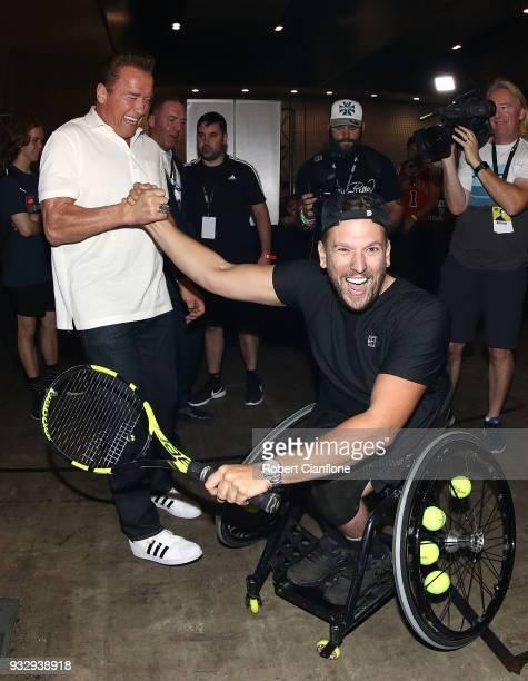 Arnold Schwarzenegger greets Australian Open wheelchair tennis champion Dylan Alcott during the Arnold Sports Festival Australia at The Melbourne...