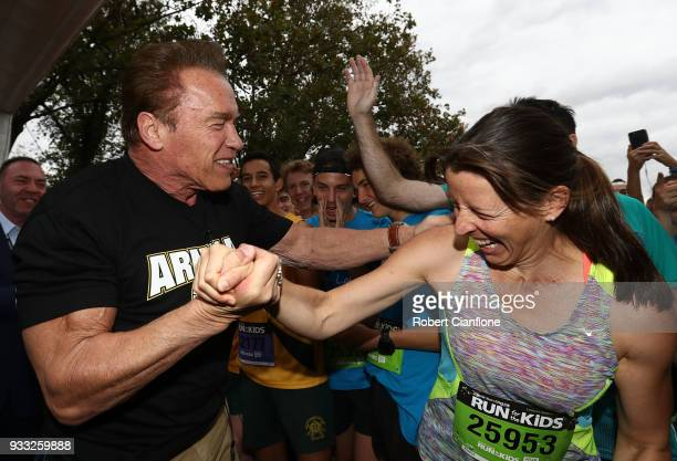 Arnold Schwarzenegger greets runners as he prepares to start the Run for the Kids charity run as part of the Arnold Sports Festival Australia at at...