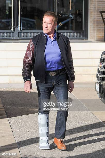 Arnold Schwarzenegger is seen shopping at Barneys New York wearing foot brace on December 16 2016 in Los Angeles California