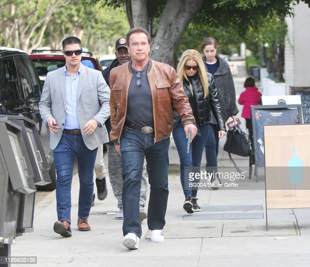 Arnold Schwarzenegger is seen with Heather Milligan and daughter Christina on November 30 2019 in Los Angeles California