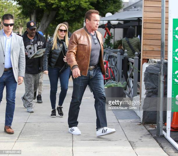 Arnold Schwarzenegger is seen with Heather Milligan on November 30 2019 in Los Angeles California