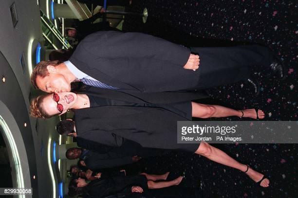 Arnold Schwarzenegger kisses Uma Thurman whilst attending the UK premier of Batman Robin in London today In the film Mr Schwarzenegger stars as...