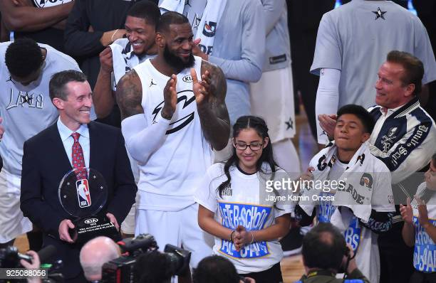 Arnold Schwarzenegger looks on as Michael Sprague COO of Kia Motors America presents LeBron James the MVP after the NBA AllStar Game 2018 at Staples...