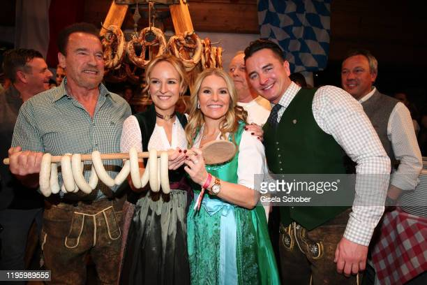 Arnold Schwarzenegger Maria Hauser Heather Milligan and Andreas Gabalier during the 29th Weisswurstparty at Hotel Stanglwirt on January 24 2020 in...