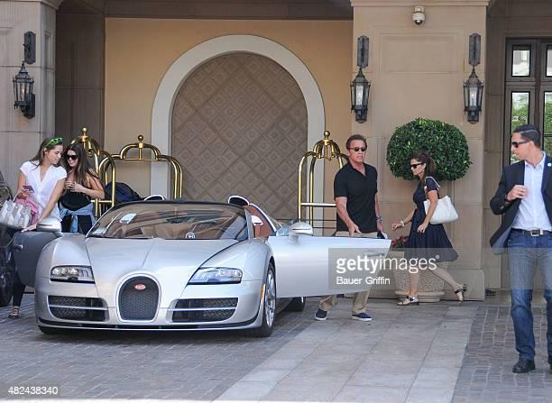 Arnold Schwarzenegger, Maria Shriver, Christina Schwarzenegger and Katherine Schwarzenegger are seen on July 30, 2015 in Los Angeles, California.