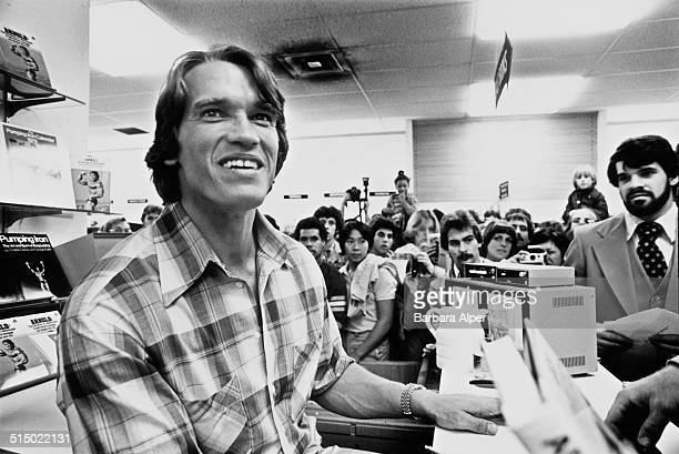 Arnold Schwarzenegger meets fans at a book signing for his autobiography/weight-training guide, 'Arnold: The Education of a Bodybuilder', Boston,...