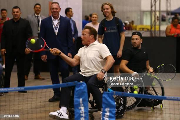 Arnold Schwarzenegger plays wheelchair tennis with Australian Open wheelchair tennis champion Dylan Alcott during the Arnold Sports Festival...