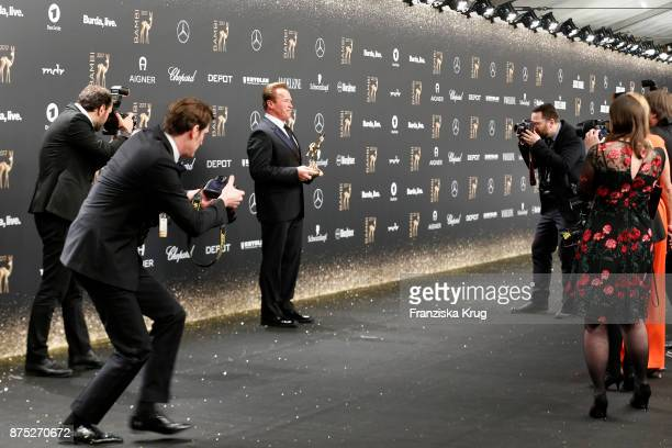 Arnold Schwarzenegger poses with an award at the Bambi Awards 2017 winners board at Stage Theater on November 16 2017 in Berlin Germany