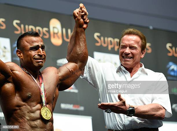 Arnold Schwarzenegger poses with Atif Anwar winner of Arnold Classic over 100 class at the Arnold Classic at The Melbourne Convention and Exhibition...