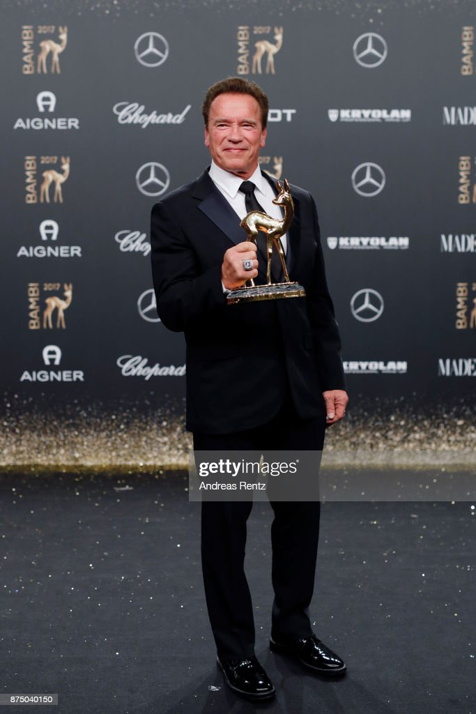 Arnold Schwarzenegger poses with award at the Bambi Awards 2017 winners board at Stage Theater on November 16, 2017 in Berlin, Germany.