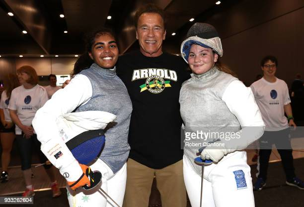 Arnold Schwarzenegger poses with fencing athletes during the Arnold Sports Festival Australia at The Melbourne Convention and Exhibition Centre on...