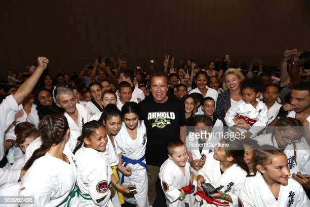 Arnold Schwarzenegger poses with martial art athletes during the Arnold Sports Festival Australia at The Melbourne Convention and Exhibition Centre...